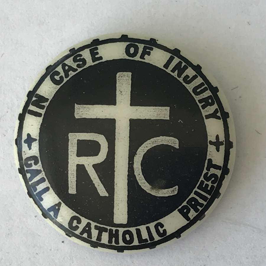 Scare button badge In case of injury call a catholic priest