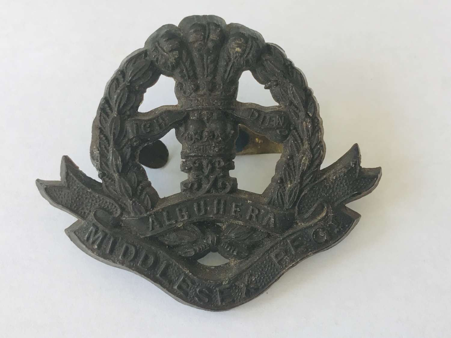 Middlesex Regiment plastic economy cap badge