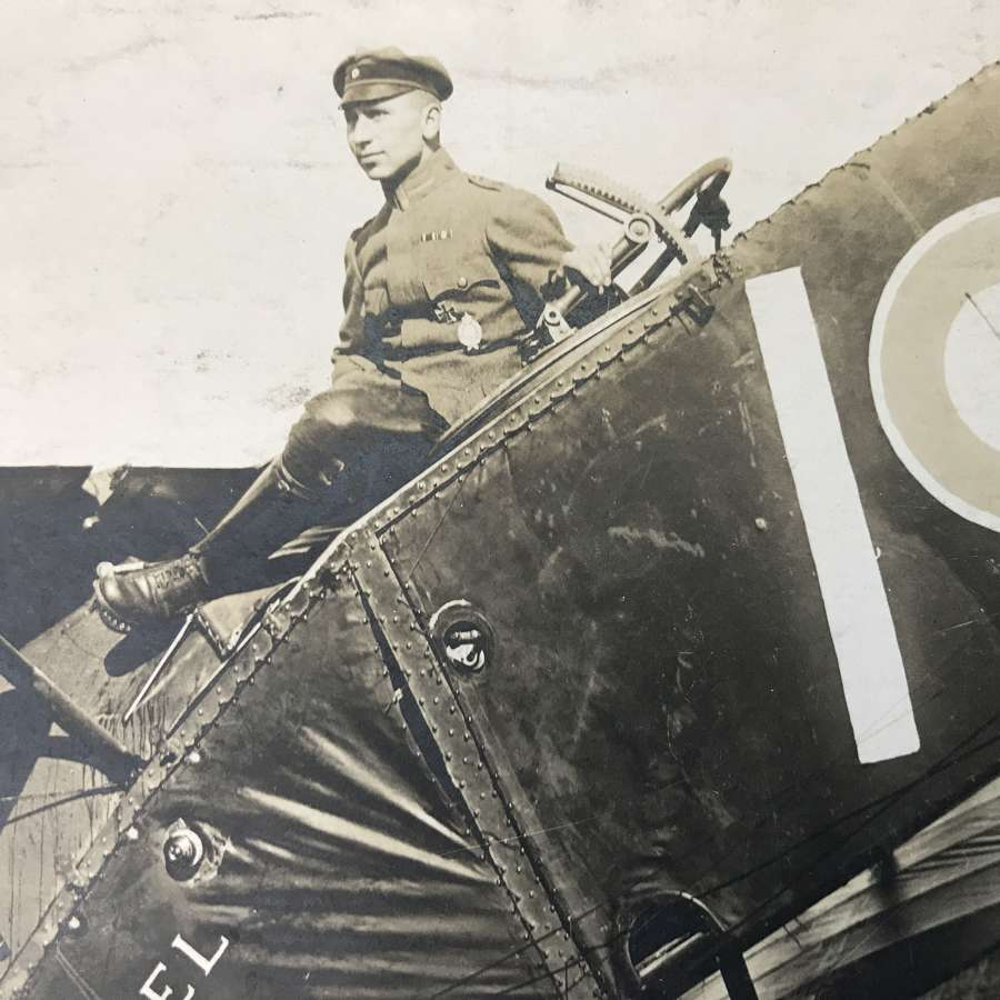 A Postcard Of a German pilot sitting on a Bristol fighter