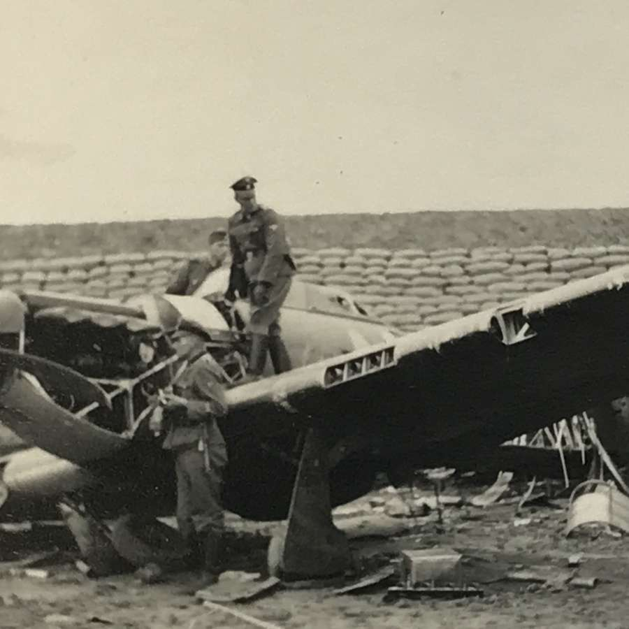 Photograph of hurricane fighter being inspected by SS troops