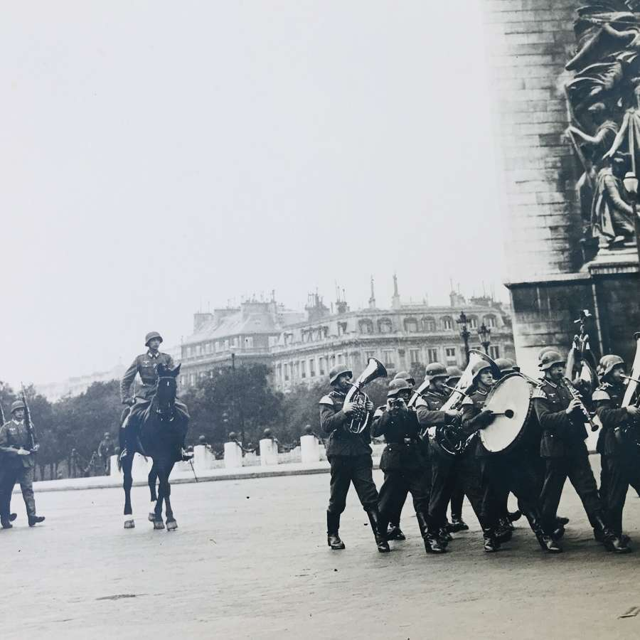 Professionally mounted photograph of German parade in Paris