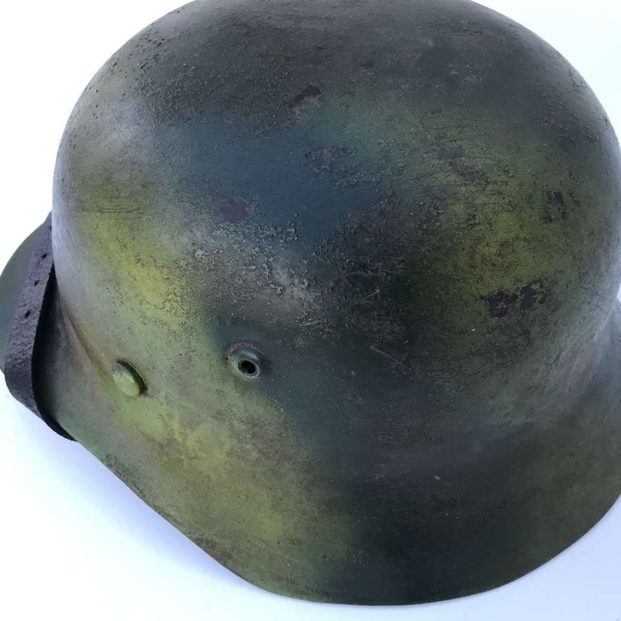 Reproduction camouflaged German helmet
