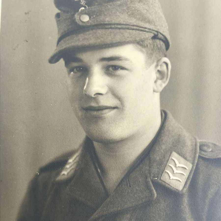 Portrait image of a Fallschirmjager  wearing M43 cap