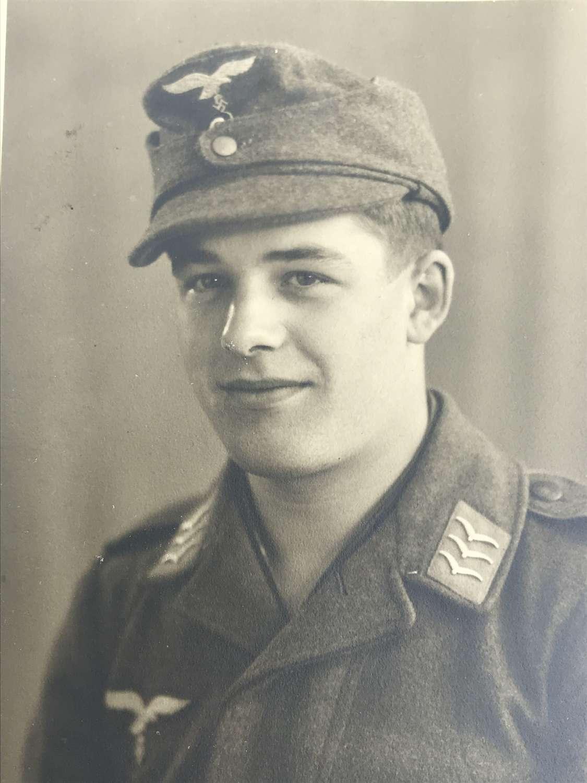 Portrait image of a Fallschirmjager  wearing M43 cap